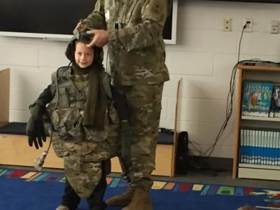 Student trying on military attire